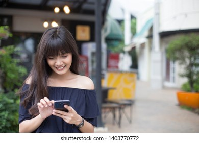Young pretty asian woman enjoy with smart phone