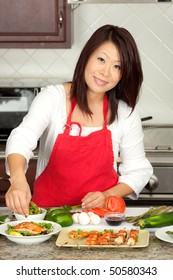 Young Pretty Asian Woman Preparing Green Healthy Food in Kitchen