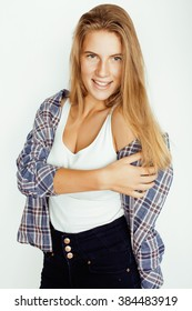 young pretty blond girl hipster posing frendly against white background wall, smiling woman with long hair
