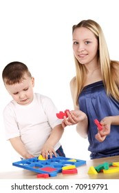 young pretty blond girl playing with cute little boy