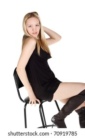 young pretty blond girl sitting on the chair