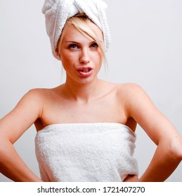 young pretty blond smiling woman with white towel on head posing cheerful on white background, lifestyle people concept