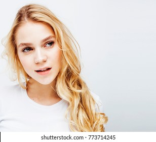 young pretty blond teenage girl emotional posing, happy smiling isolated on white background, lifestyle people concept