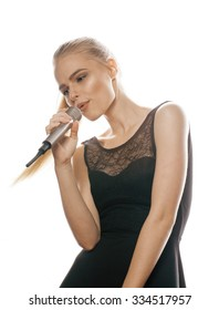 young pretty blond woman singing in microphone isolated close up on white