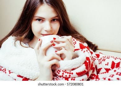 young pretty brunette girl in Christmas ornament blanket getting warm on cold winter, freshness beauty concept, lifestyle people