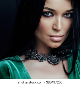 young pretty brunette woman fashion dressed, bright makeup, elegant hair style
