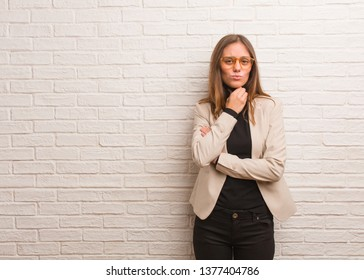 Young pretty business entrepreneur woman coughing, sick due a virus or infection