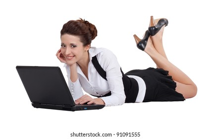 Young pretty business woman laying near her laptop