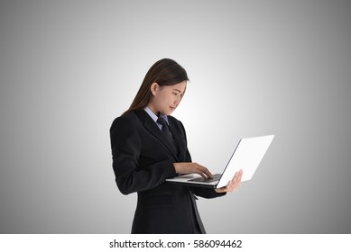 Young pretty business woman with notebook over a grey background.