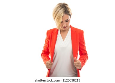 Young pretty business woman opening jacket isolated on white background with copyspace advertising area