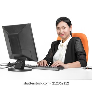 Young pretty business woman using computer on desk