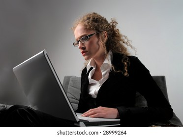 young pretty business woman using laptop