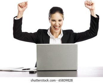 Young and pretty Businesswoman excited looking at laptop