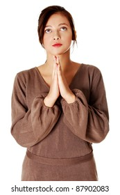 Young pretty caucasian girl standing and praying. Isolated on white.