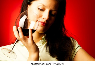young pretty caucasian woman with wine over red