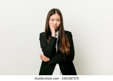 Young pretty chinese business woman who is bored, fatigued and need a relax day.