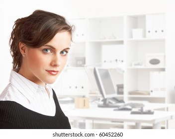 young pretty dark haired secretary standing in office