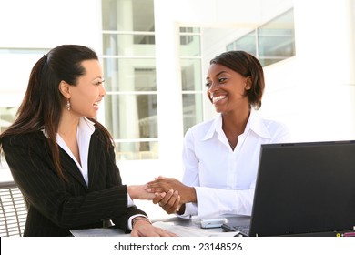 Young pretty and diverse women business team at office