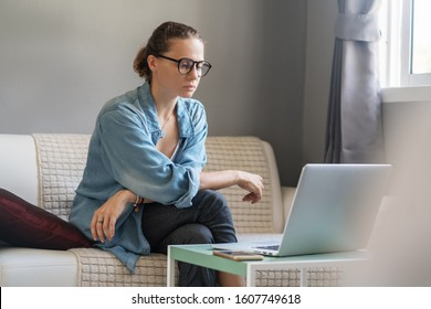 Young pretty european woman with glasses psychologist coach holds an online session on the internet, remote work from home, online consultations