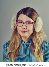 young pretty fair-haired teenage girl in glasses emotional posing ,  lifestyle people concept