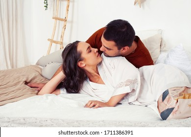 young pretty family, man and woman together in bed feeling calm and relax, lifestyle people concept