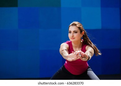 Young pretty fit woman working out at the athletic field. Fitness, sport, training, motivation, hard working and lifestyle concept