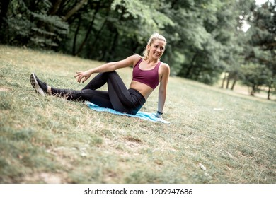 Young pretty fitness sporty woman doing joga outdoor