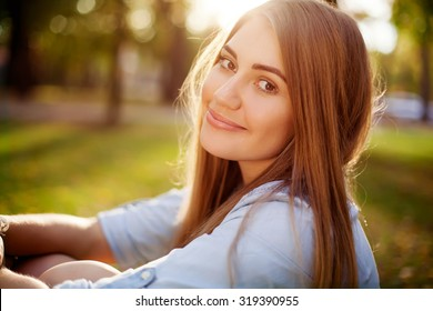Young pretty girl in autumn park