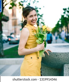 young pretty girl in city outdoor with flowers, lifestyle people concept