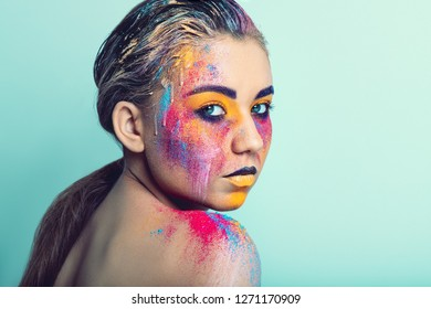 Young pretty girl with colorful creative make-up, studio shoot