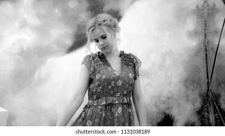 Young pretty girl in dress like in smoke