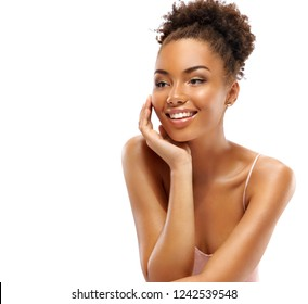 Young pretty girl with flawless skin. Photo of happy smiling african girl isolated on white background. Youth and skin care concept