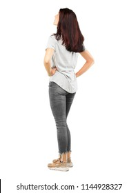 young pretty girl full body smiling and looking upwards, towards the sky or to the spot where the publicist may place a concept or message. Lateral rear view.