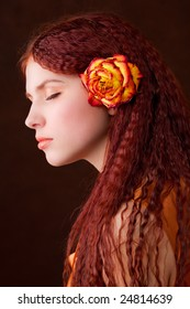 Young pretty girl with long hair and a flower
