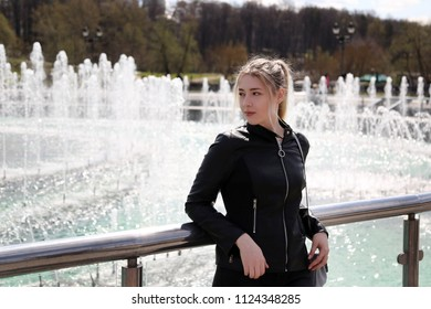 Young pretty girl on Moscow city background outdoor, Russian student