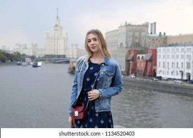 Young pretty girl on Moscow city an river background outdoor, Russian student