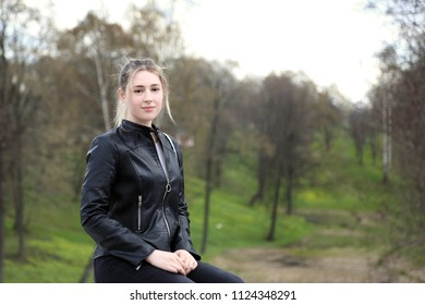 Young pretty girl portrait on natural landscape background outdoor