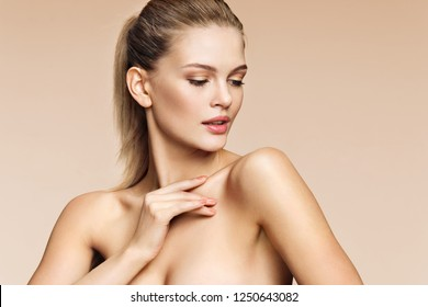 Young pretty girl with professional makeup on beige background. Beauty