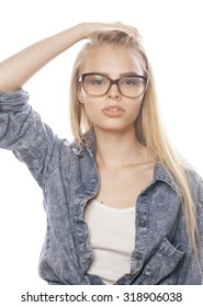 young pretty girl teenager in glasses on white isolated blond hair close up