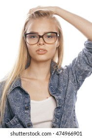 young pretty girl teenager in glasses on white isolated blond hair modern hipster