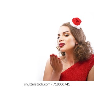 young pretty happy smiling brunette woman on christmas in santas