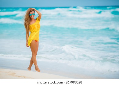 Young pretty hot sexy woman on the tropic island in summer near the sea and blue sky having fun. Young caucasian woman near ocean beach