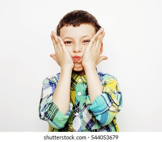 young pretty little boy kid wondering, posing emotional face isolated on white background, gesture happy smiling close up, lifestyle people concept
