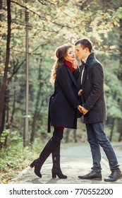 Young pretty loving stylish couple have a nice day in autumn park. Season, beauty, love concept