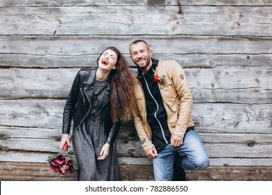 Young pretty loving stylish couple huggingeach other and have a nice day in autumn park. Season, beauty, love concept