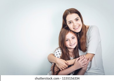 Young Pretty Mom hugging Happy Daughter in the Mother Day. Love and Family Concept.