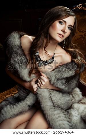 Nude woman fur coat