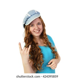 Young pretty redhead girl in cap shows heavy metal gesture isolated on white background in square - beautiful groupie
