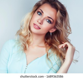 young pretty stylish blond hipster girl posing emotional isolated on white background happy smiling cool smile, lifestyle people concept
