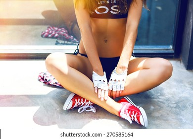 Young pretty teen girl with perfect slim fit body wearing stylish hipster outfit, posing on urban background, bright summer fashion portrait.